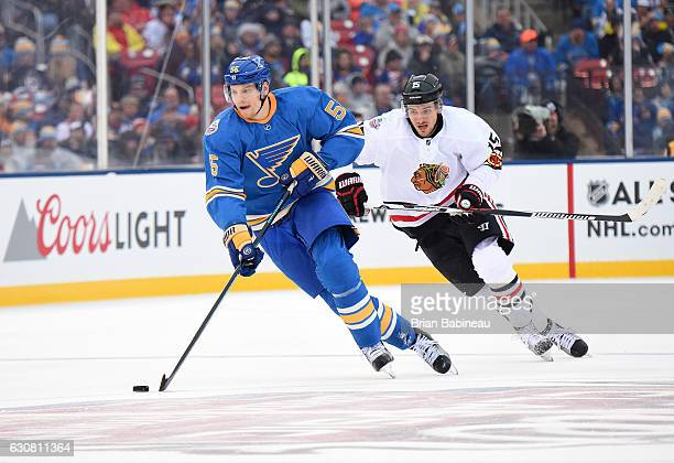 Colton Parayko of the St Louis Blues skates the puck through neutral zone as Artem Anisimov of the Chicago Blackhawks pursues the play the 2017...