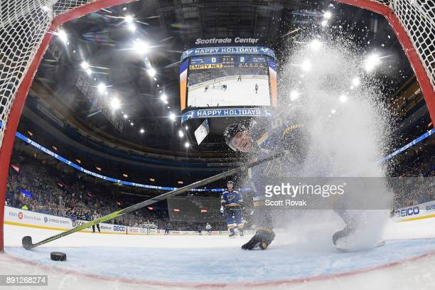 Colton Parayko of the St Louis Blues slides into the net after attempting to block an empty net goal by the Tampa Bay Lightning at Scottrade Center...