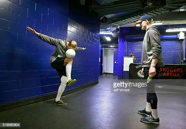 Colton Parayko watches Carl Gunnarsson of the St Louis Blues balance on one leg as he warms up for their NHL game against the Vancouver Canucks at...