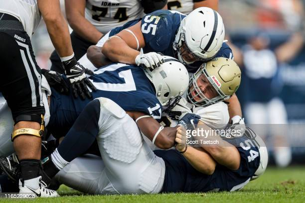 Colton Richardson of the Idaho Vandals is sacked by Antonio Shelton Garrett Taylor and Robert Windsor of the Penn State Nittany Lions during the...
