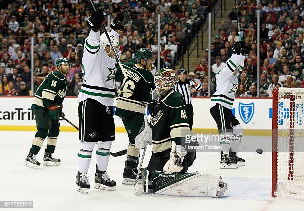 Colton Sceviour and Kris Russell of the Dallas Stars celebrate a goal against Devan Dubnyk of the Minnesota Wild by teammate Ales Hemsky on the power...