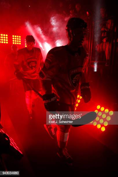 Colton Sceviour and teammate Maxim Mamin of the Florida Panthers head out to the ice for introductions prior to the start of the game against the...