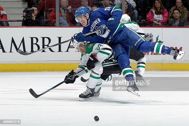 Colton Sceviour of the Dallas Stars checks Adam Cracknell of the Vancouver Canucks during their NHL game at Rogers Arena December 3, 2015 in...