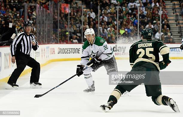 Colton Sceviour of the Dallas Stars controls the puck against Jonas Brodin of the Minnesota Wild during the second period of Game Three of the...