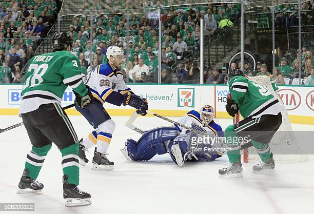 Colton Sceviour of the Dallas Stars shoots the puck against Kevin Shattenkirk of the St Louis Blues and Brian Elliott of the St Louis Blues in the...