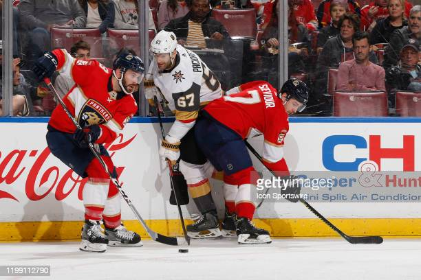 Colton Sceviour of the Florida Panthers checks Max Pacioretty of the Vegas Golden Knights as Keith Yandle skates off with the puck during second...