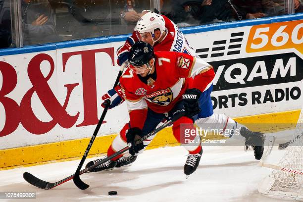 Colton Sceviour of the Florida Panthers crosses sicks with Kenny Agostino of the Montreal Canadiens at the BBT Center on December 28 2018 in Sunrise...