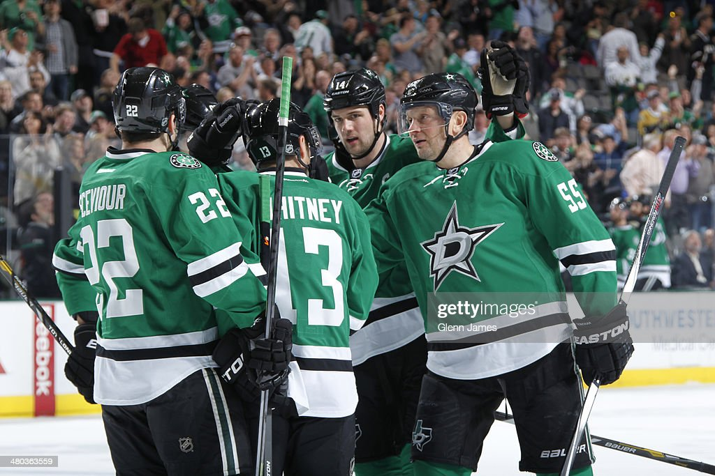 Colton Sceviour #22, Sergei Gonchar #55, Jamie Benn #14 and Ray Whitney #13 of the Dallas Stars celebrate a goal against the Winnipeg Jets at the American Airlines Center on March 24, 2014 in Dallas, Texas.