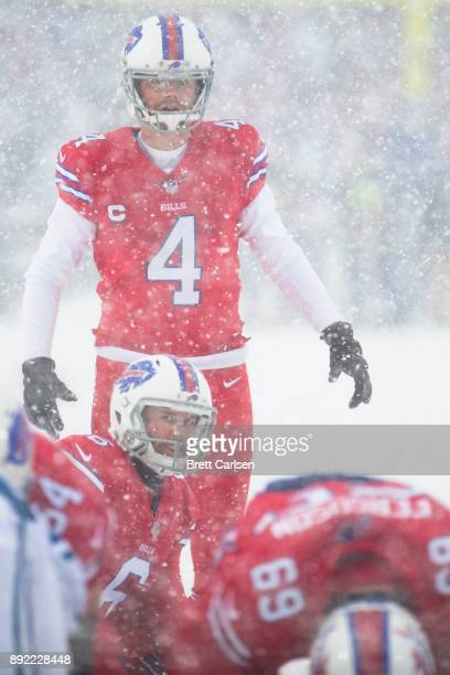 Colton Schmidt and Stephen Hauschka of the Buffalo Bills ready for the snap on a successful point after try during the second quarter against the...