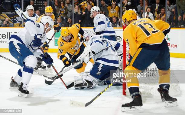 Colton Sissons and Nick Bonino of the Nashville Predators battle in close on goalie Louis Domingue of the Tampa Bay Lightning as Tyler Johnson...