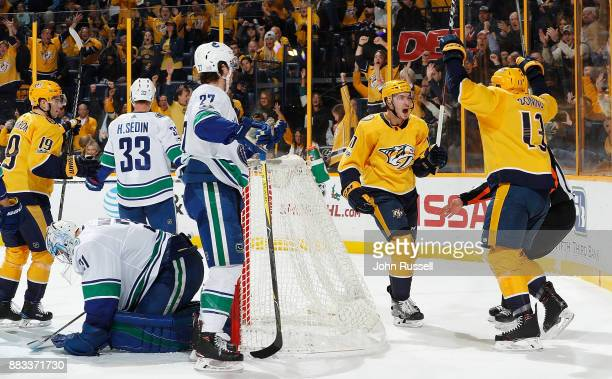 Colton Sissons celebrates the goal of Nick Bonino of the Nashville Predators against Anders Nilsson and Ben Hutton of the Vancouver Canucks during an...