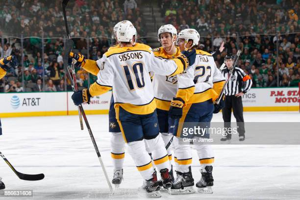 Colton Sissons Kevin Fiala and the Nashville Predators celebrate a goal against the Dallas Stars at the American Airlines Center on December 5 2017...