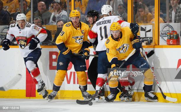Colton Sissons of the Nashville Predators battles along the boards for the puck against Jonathan Huberdeau of the Florida Panthers during an NHL game...