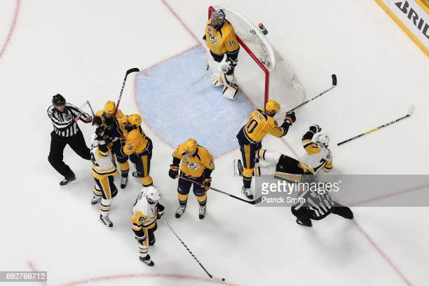 Colton Sissons of the Nashville Predators checks Evgeni Malkin of the Pittsburgh Penguins during the first period during Game Four of the 2017 NHL...