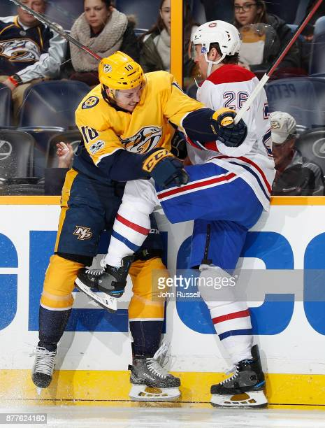 Colton Sissons of the Nashville Predators checks Jeff Petry of the Montreal Canadiens during an NHL game at Bridgestone Arena on November 22 2017 in...