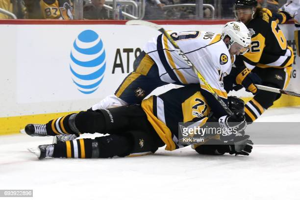Colton Sissons of the Nashville Predators collides with Evgeni Malkin of the Pittsburgh Penguins in the second period in Game Five of the 2017 NHL...