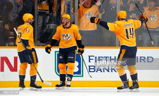 Colton Sissons of the Nashville Predators is congratulated by teammates Nick Bonino and Mattias Ekholm after scoring the game winning overtime goal...