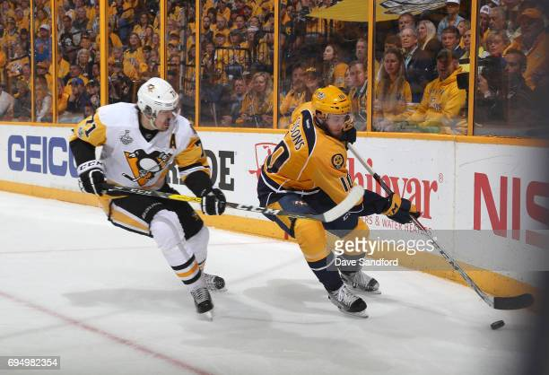 Colton Sissons of the Nashville Predators plays the puck in the corner from Evgeni Malkin of the Pittsburgh Penguins in the first period of Game Six...
