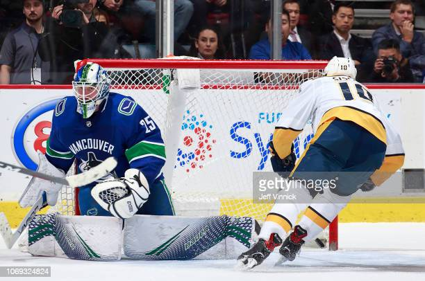 Colton Sissons of the Nashville Predators scores omg Jacob Markstrom of the Vancouver Canucks during their NHL game at Rogers Arena December 6, 2018...