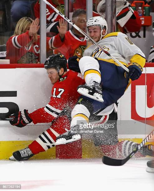 Colton Sissons of the Nashville Predators slams Lance Bouma of the Chicago Blackhawks in the boards at the United Center on October 27 2017 in...