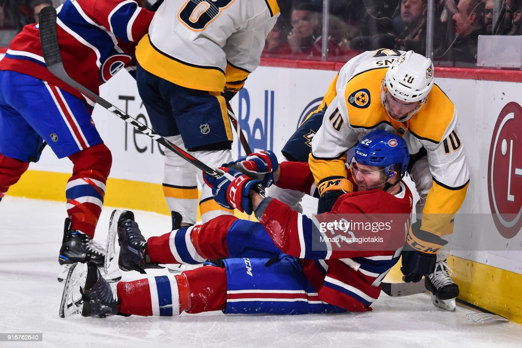 Colton Sissons #10 of the Nashville Predators takes down Karl Alzner #22 of the Montreal Canadiens during the NHL game at the Bell Centre on February 10, 2018 in Montreal, Quebec, Canada. The Nashville Predators defeated the Montreal Canadiens 3-2 in a shootout.