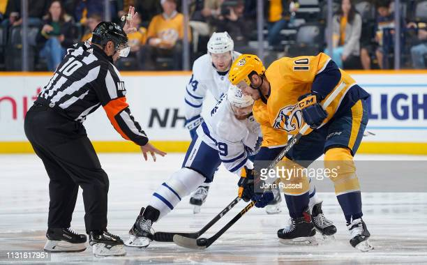 Colton Sissons of the Nashville Predators wins a faceoff against William Nylander of the Toronto Maple Leafs at Bridgestone Arena on March 19 2019 in...
