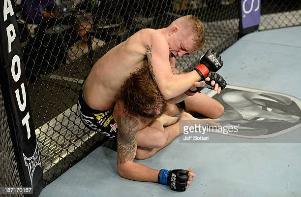 Colton Smith elbows Michael Chiesa in their UFC lightweight bout on November 6 2013 in Fort Campbell Kentucky