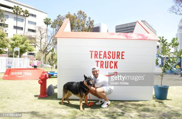 Colton Underwood and Kane his rescue dog from Korea enjoy the Amazon Treasure Truck Pup Fest Event on May 5 2019 in Los Angeles California For more...