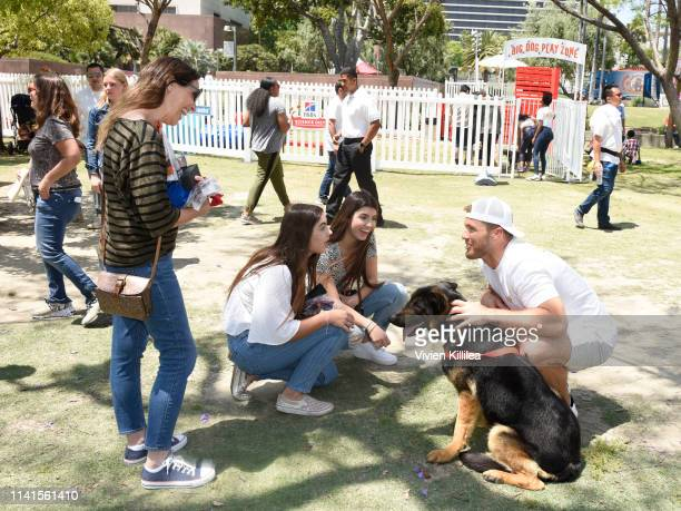 Colton Underwood and Kane his rescue dog from Korea meet fans at the Amazon Treasure Truck Pup Fest Event on May 5 2019 in Los Angeles California For...