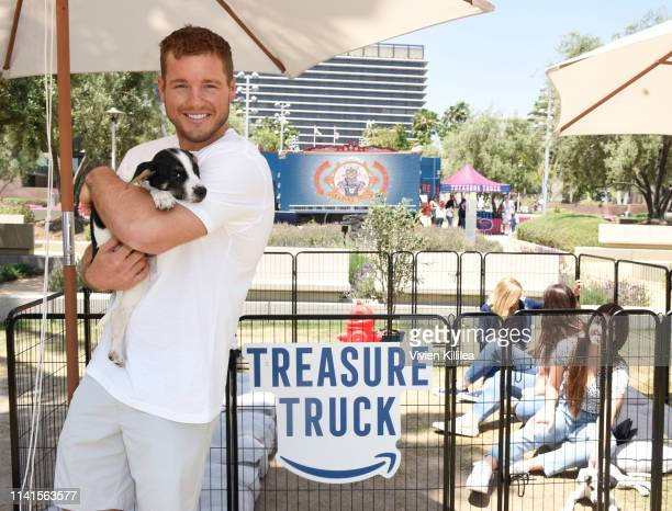 Colton Underwood and Oreo who is an adoptable puppy from the Vanderpump Dog Foundation enjoy the Amazon Treasure Truck Pup Fest Event on May 5 2019...