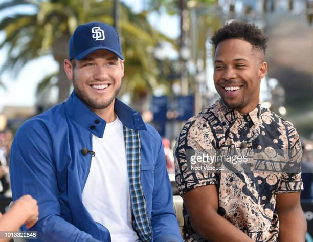 """Colton Underwood and Wills Reid visit """"Extra"""" at Universal Studios Hollywood on August 8, 2018 in Universal City, California."""