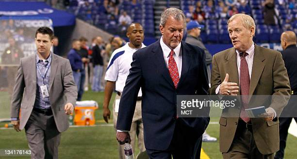 Colts owner Jim Irsay leaves the field with Vice Chairman Bill Polian as Vice President and General Manager Chris Polian leave the field before their...