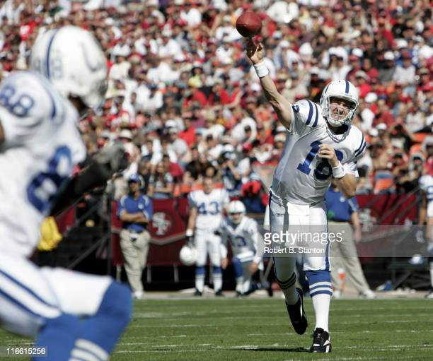 Colts quarterback Peyton Manning fires one to receiver Marvin Harrison in the first half as the Indianapolis Colts defeated the San Francisco 49ers...