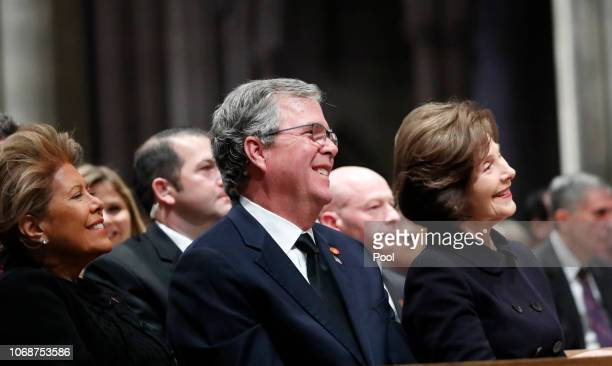 Columba Bush Jeb Bush and Laura Bush listen as former President George W Bush speaks during the State Funeral for former President George HW Bush at...