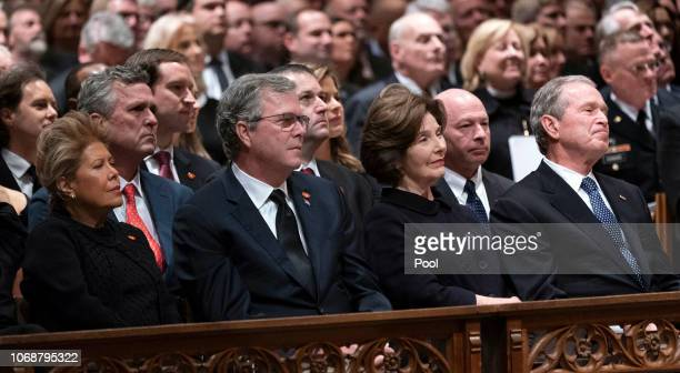 Columba Bush, Jeb Bush, Laura Bush and George W. Bush attend the state funeral service of former President George W. Bush at the National Cathedral,...