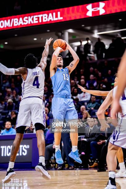 Columbia Lions guard Gabe Stefanini goes up for a shot against Northwestern Wildcats forward Vic Law during a game between the Columbia Lions and the...