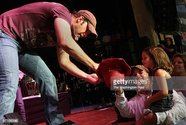 Columbia MD Country music performers Rodney Atkins and Sugarland at Merriweather Post Pavilion Randy Atkins signs 5yrold Olivia Reynolds's red cowboy...