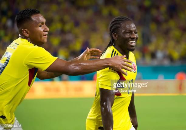 Columbia Midfielder Yimmi Chara smiles as he celebrates scoring a goal with Columbia Forward Alfredo Morelos during an International friendly soccer...