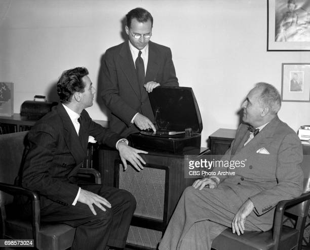 Columbia Records introduces long playing microgroove records Pictured from left is Columbia Records executive Goddard Lieberson CBS chief engineer Dr...