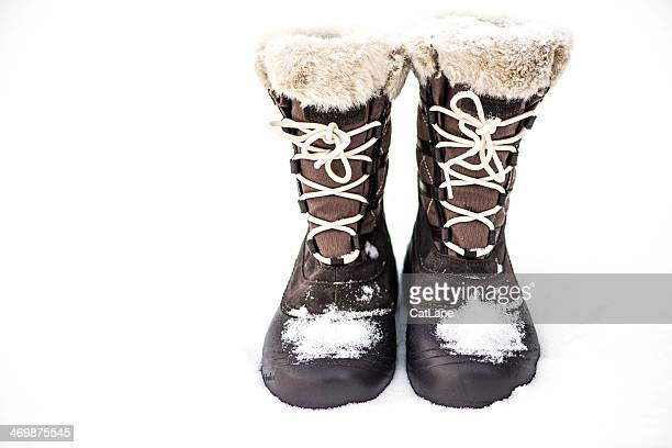 columbia snow boots in freshly snowfall - snow boot stock photos and pictures