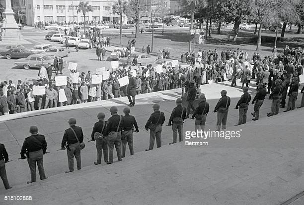 Columbia South Carolina Some 700 Negro students waving placards marched on the South Carolina state house in protest of three Negro youths killed at...