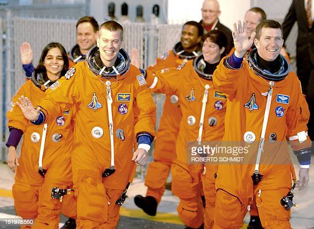 Columbia space shuttle Commander Rick Husband waves as he and mission specialist Kalpana Chawla Israeli astronaut Ilan Ramon Shuttle pilot William...