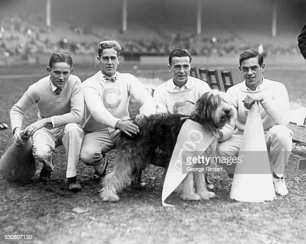 Columbia University cheerleaders Sullivan Walker Campbell and Winkoop with their canine mascot Peter at the Thanksgiving Day Game in New York when...