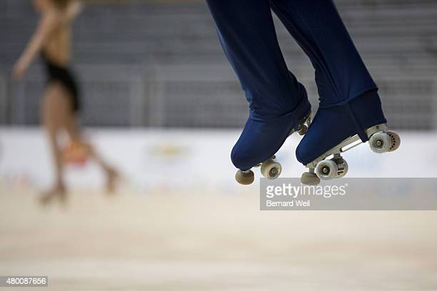 TORONTO ON JULY 9 Columbian Roller Figure Skater Diago Duque gets airborne as he practices his routine during a training session as Canadian Kailah...