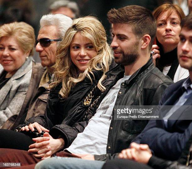 Columbian singer Shakira, Barcelona footballer Gerard Pique and Shakira's parents Nidia Ripoll and William Mebarak attend a press conference for his...