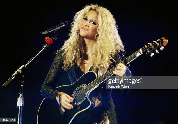 Columbian singer Shakira performs at a concert during her Tour Of The Mongoose May 11 2003 in Caracas Venezuela