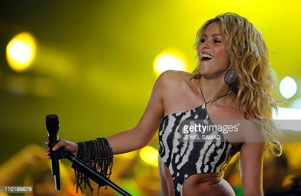 Columbian singer Shakira performs 'Woka Woka' the FIFA World Cup 2010 anthem during the Kickoff Concert at the Orlando Stadium in Johannesburg on...