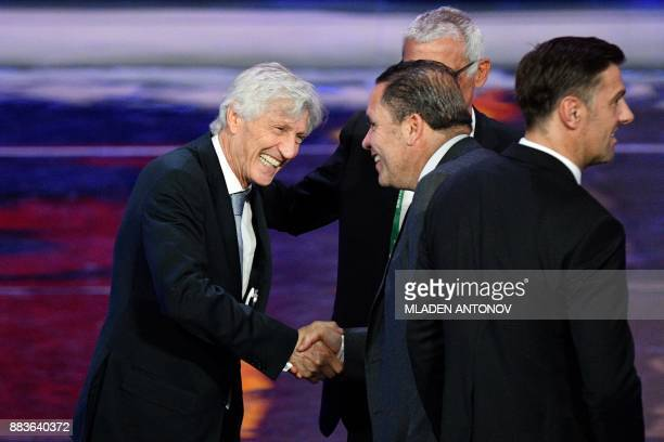 Columbia's national football team coach Jose Pekerman shakes hands with Tunisia's national football team coach Nabil Maaloul during the Final Draw...