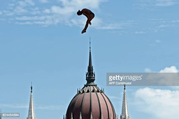 TOPSHOT Columbia's Orlando Duque competes in round 3 of the men's High Diving competition at the 2017 FINA World Championships in Budapest on July 30...