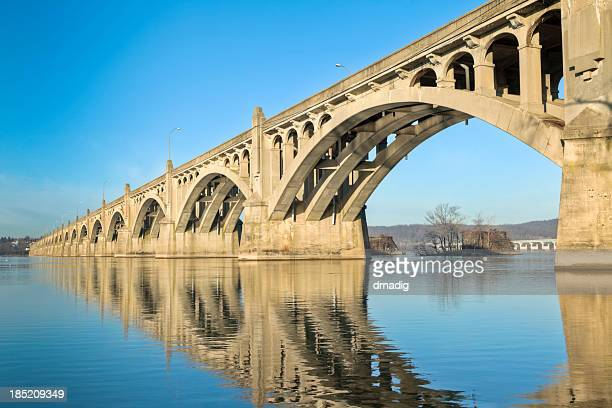 columbia-wrightsville bridge with reflection in the susquehanna river - lancaster county pennsylvania stock pictures, royalty-free photos & images